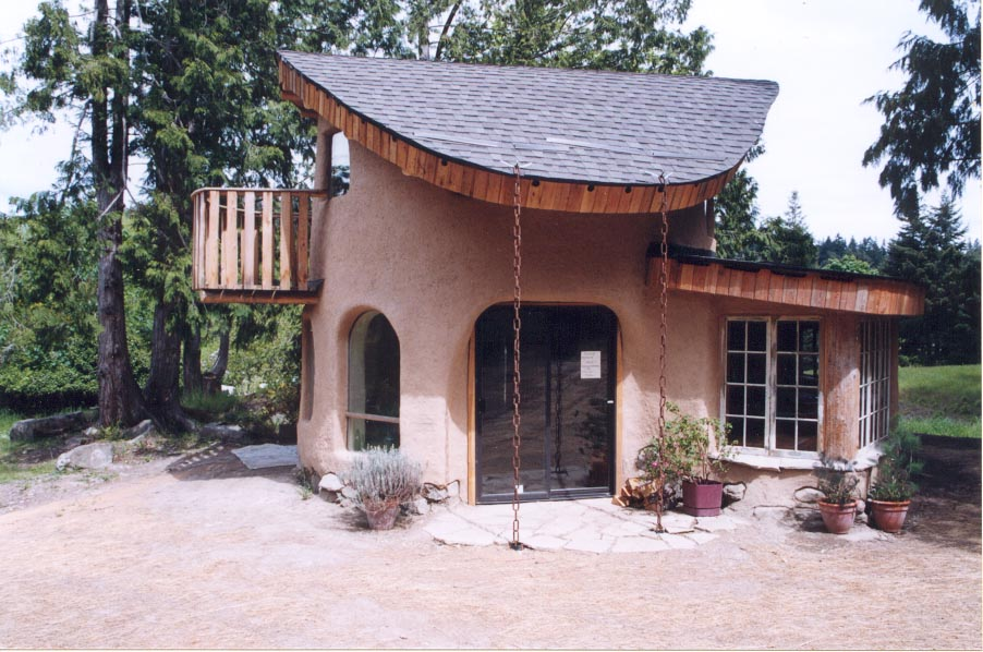 Home styles clay house style for Adobe house construction cost