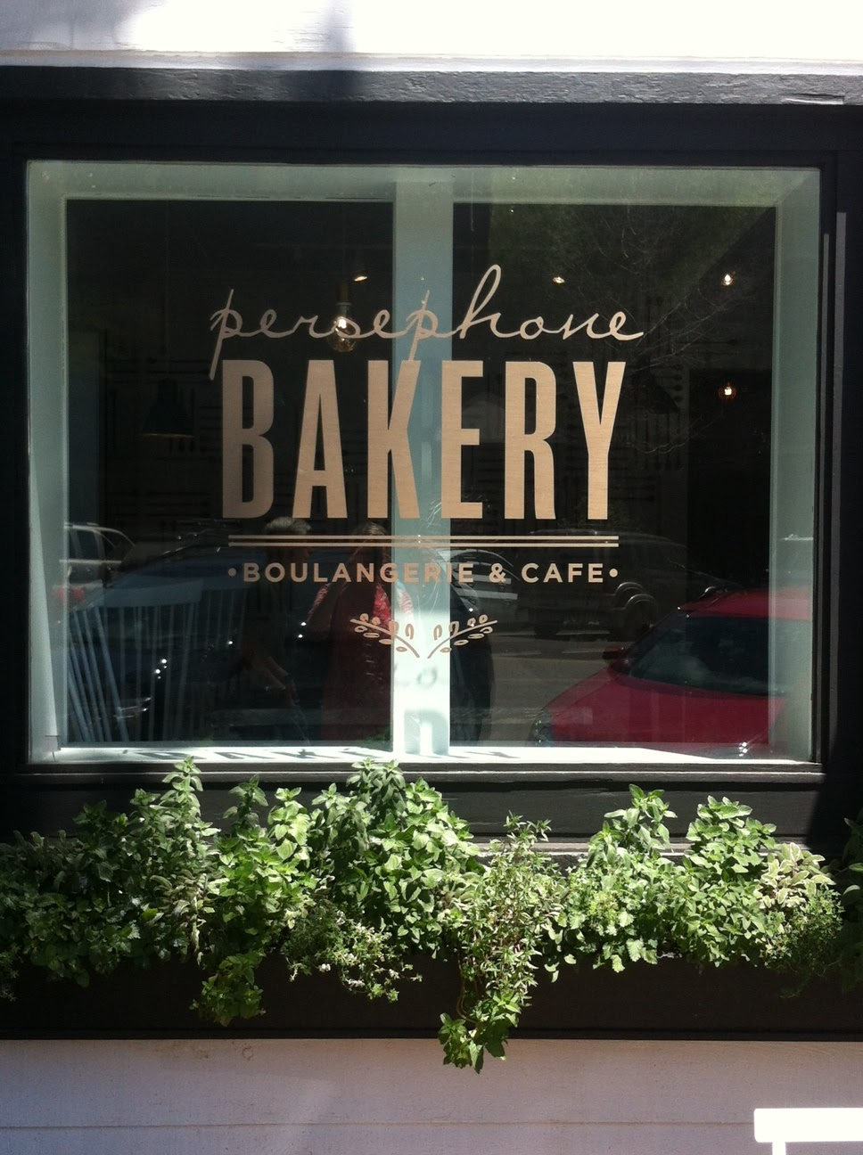 Delight by design new kid on the block persephone bakery for Restaurant window design