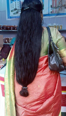 Indian Aunt with dark black long wet hair.