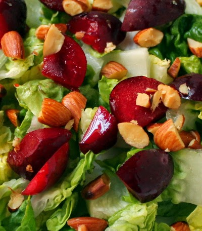 Salad of plums, almonds, and arugula