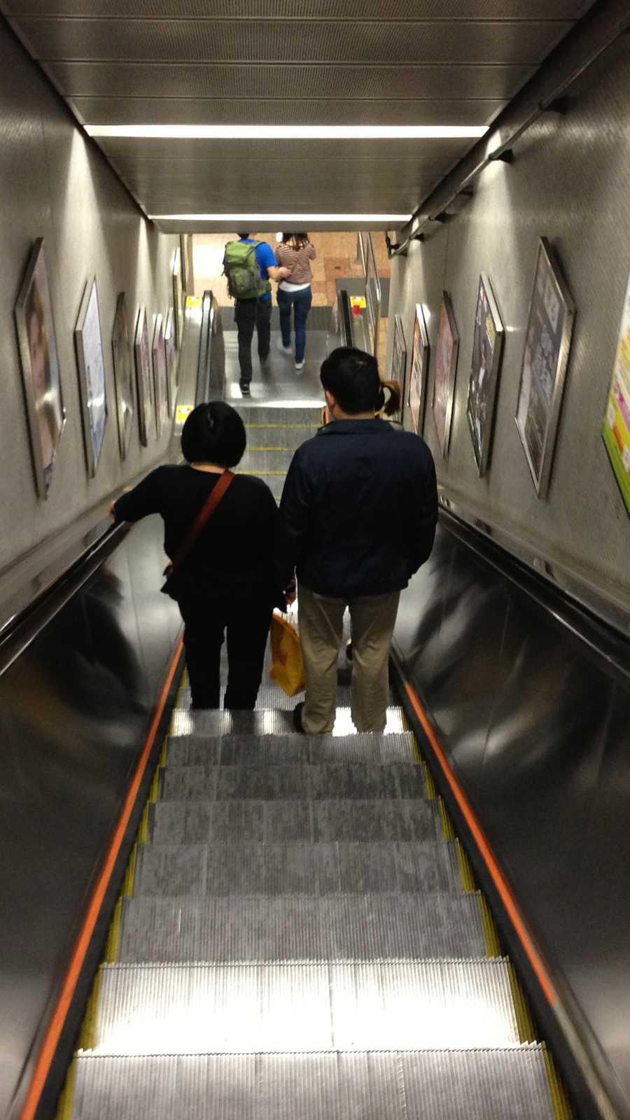A couple heads down the MTR station in Mong Kok.