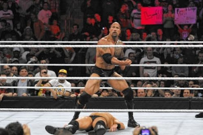 WCC Excess of Madness Rock-wwe-peoples-elbow