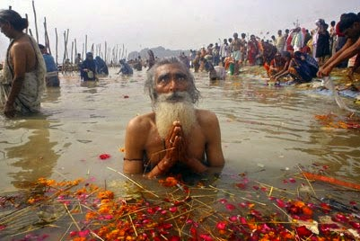 Taking dip in Holy River Ganga
