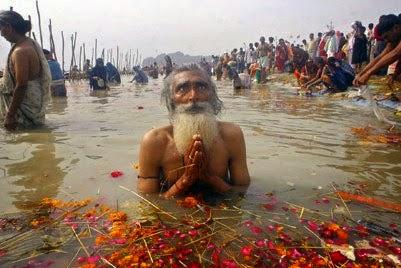 Taking dip in Holy River Ganga