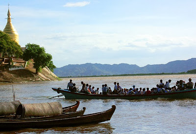 Busy traffic on the Irrawaddy River at the foot of the pagodas