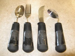 spoon, fork and knife all with large easy to grip rubber bases