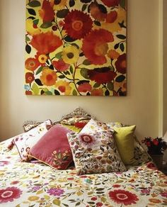 designers bedroom with Kim Parker art on the headboard