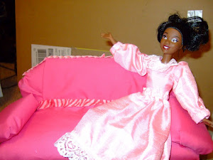 Tiana loves her pink sofa