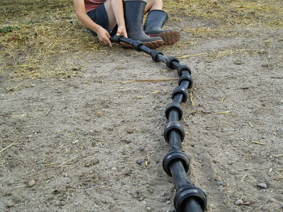 farm boy making snake with inflations