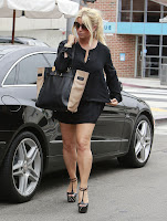 Jessica Simpson leggy in a short black skirt