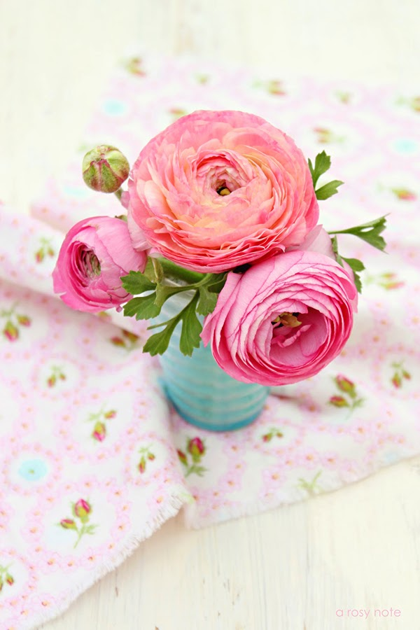 Ranunculus on a floral fabric backdrop by A Rosy Note