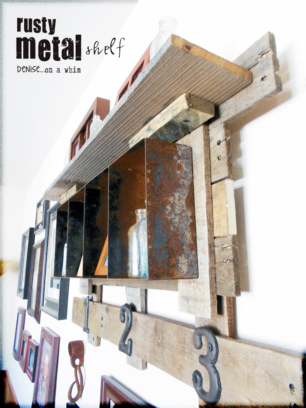 Rustic pallet wood is the perfect backdrop for a rusty bin shelf via http://deniseonawhim.blogspot.com