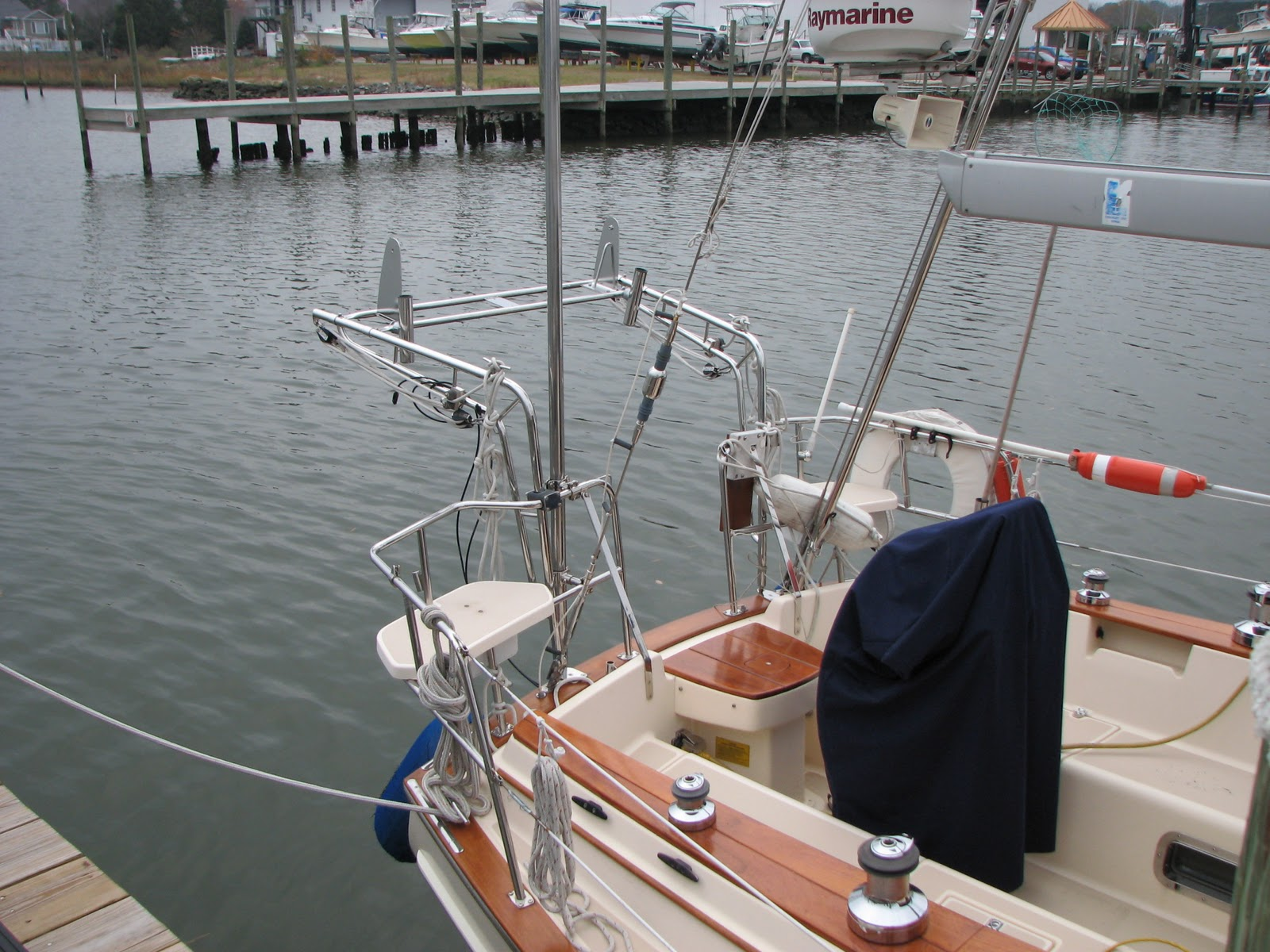 Marine solar panel installations first mate marine inc - The Panels Attached To The Support Bars With Pivot Hardware Will Attach To The Supports Mounted On The Kato Dinghy Davits We Just Have To Thread The