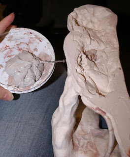 add base to clay sculpture