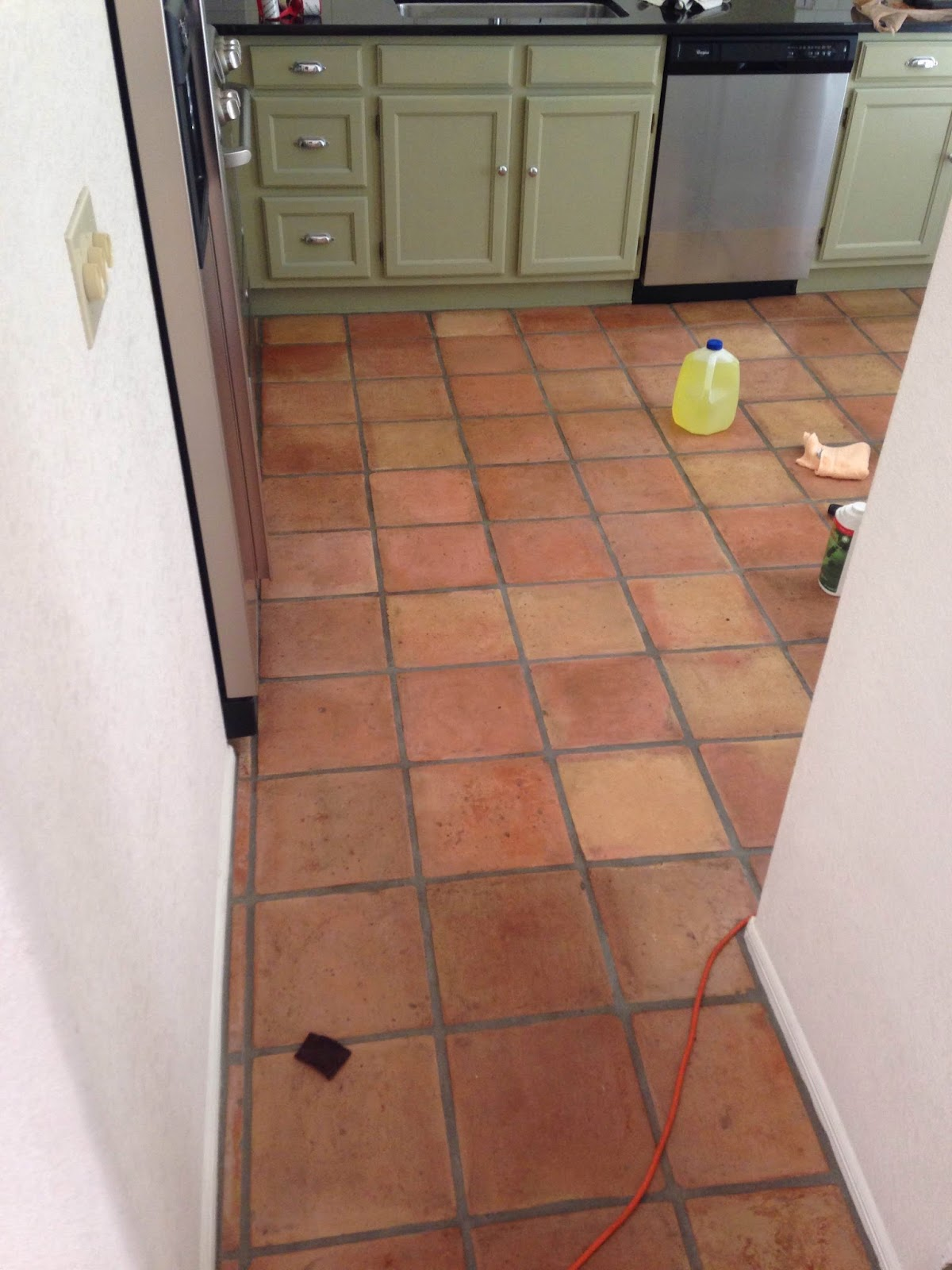 Dusty coyote stripping and sealing a saltillo tile floor after the sealant is removed the tiles should look dull like below dailygadgetfo Images