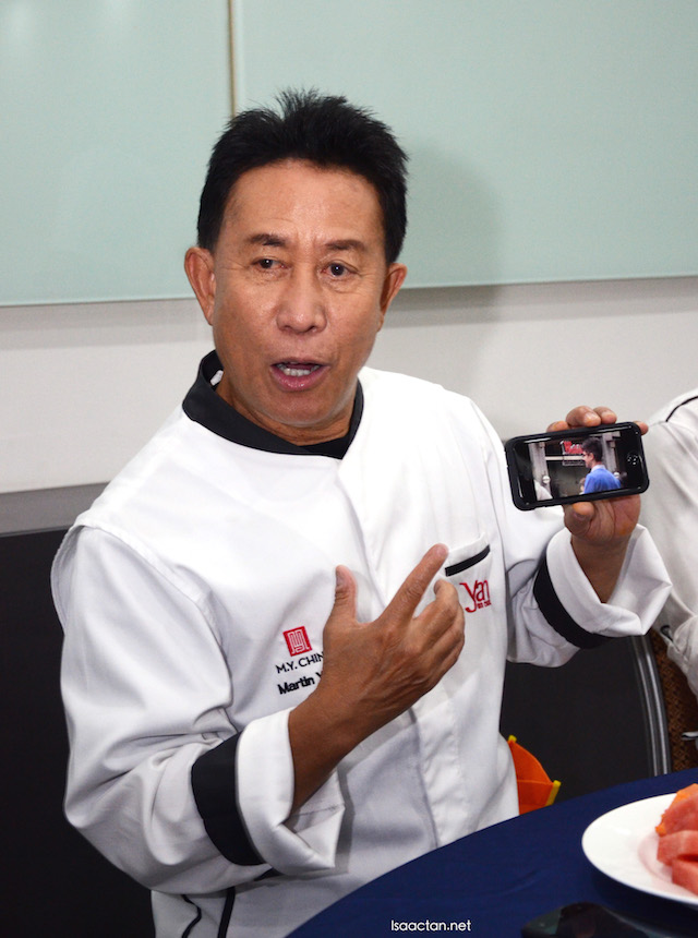 Chef Martin Yan showing us a clip of one of his newly opened restaurant in the USA.