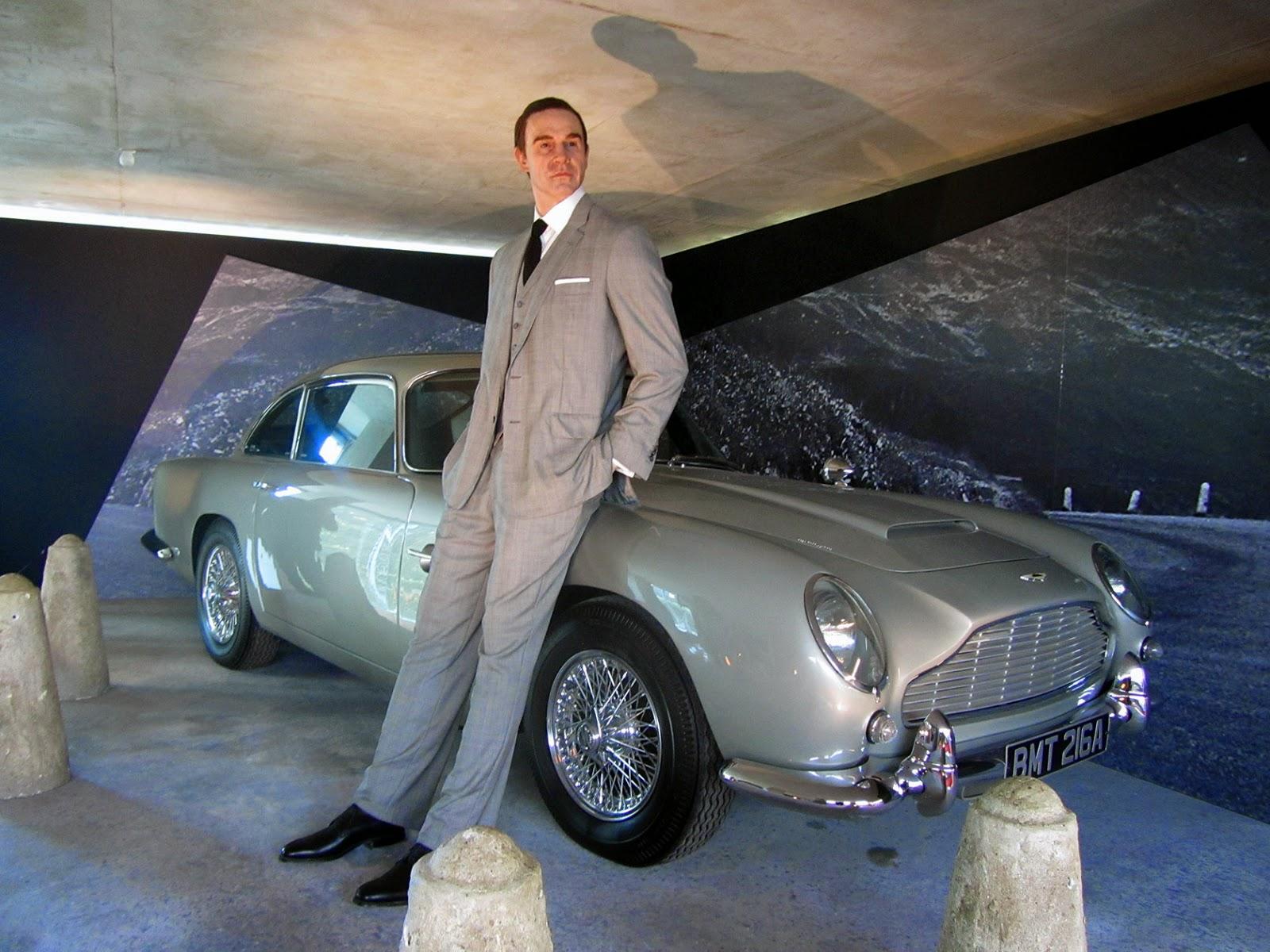 Sean Connery as James Bond with a 1964 silver Aston Martin DB5