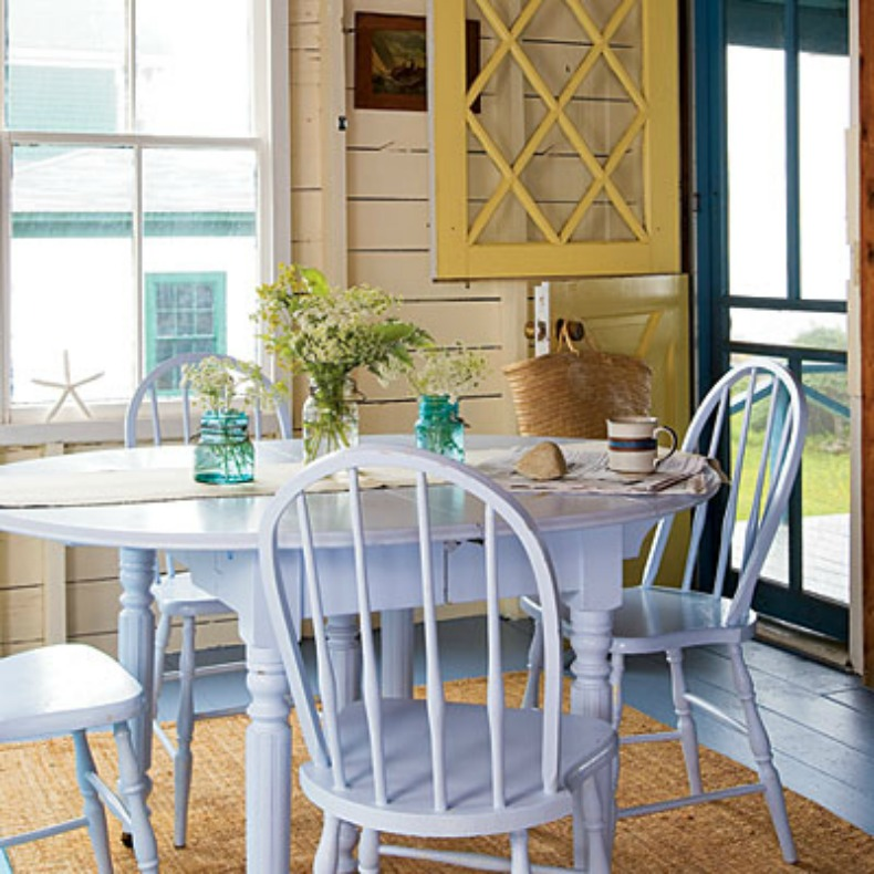 light blue cottage chairs and breakfast table with bright framed
