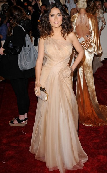 Salma Hayek in a curve-hugging, beige nude dress from Alexander McQueen at the 2011 MET Gala.