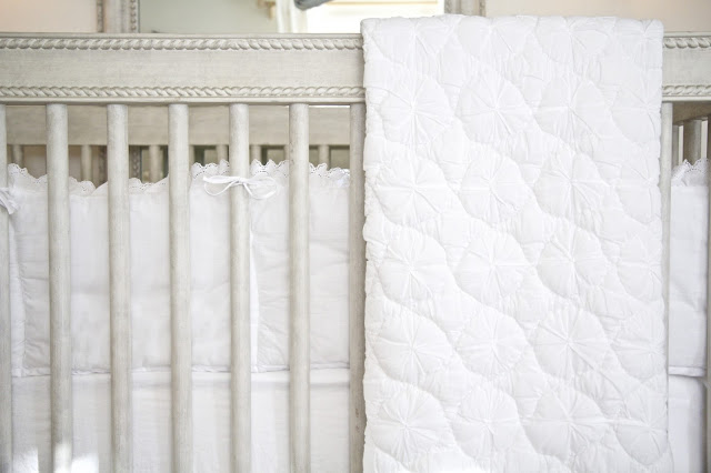 Crib sheets and quilt by Restoration Hardware; Baby Tools in the Nest; Nora's Nest