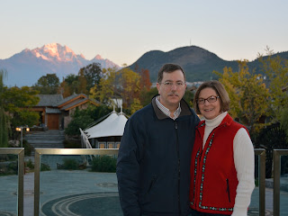 Tom and Margot Savage on the balcony of the Crowne Plaza in Lijiang, Yunnan, China