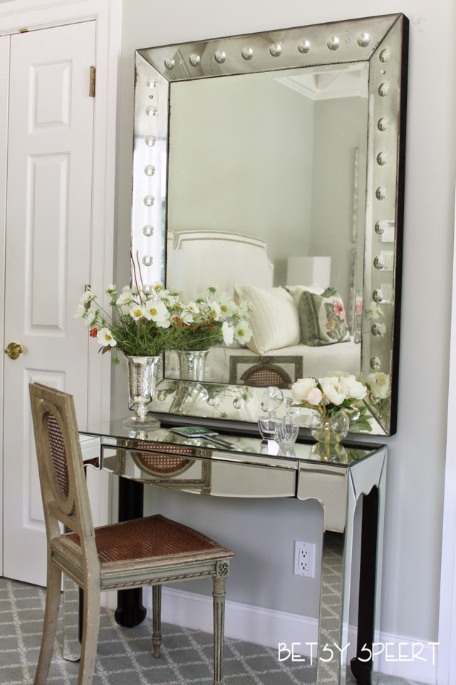 as i had shown you we had hung a venetian mirror over her dressing table