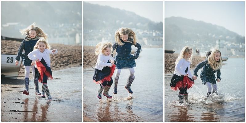 Two sisters jumping in the waves