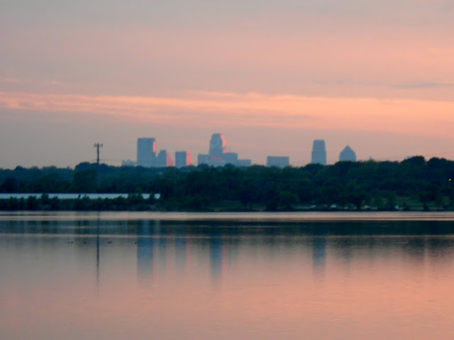 The sunset at White Rock Lake, Dallas, TX with the city in the background