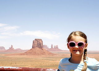 Tessa at Monument Valley Navajo Tribal Park. The landscape looks a bit hazy in the background due to a whole lot of blowing dust!