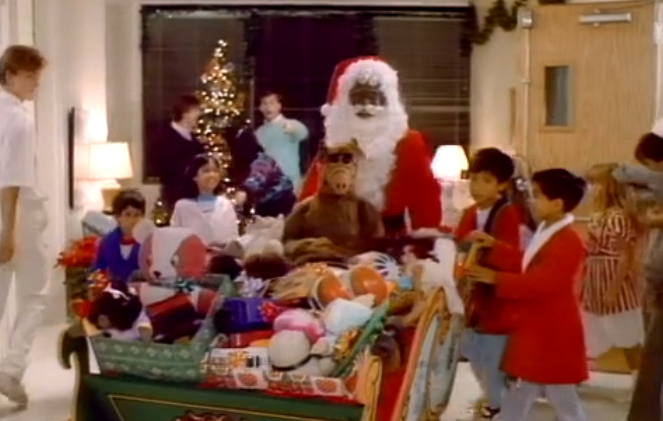 santa claus distributes toys at the childrens hospital while alf hides in plain sight - Alf Halloween Episode