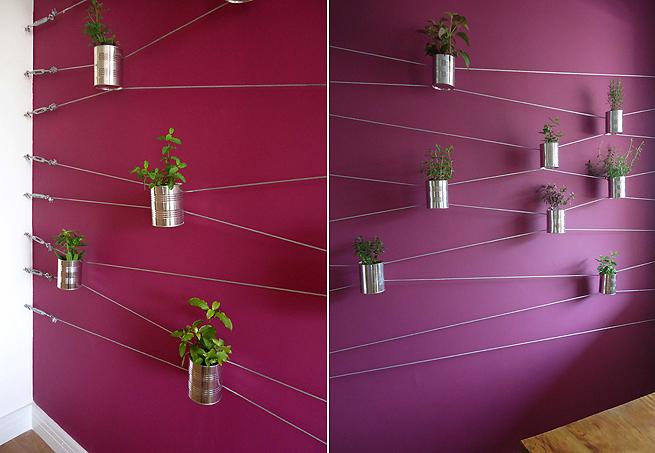 jardim vertical latas:jardim vertical, com latas presas a cabos de aço