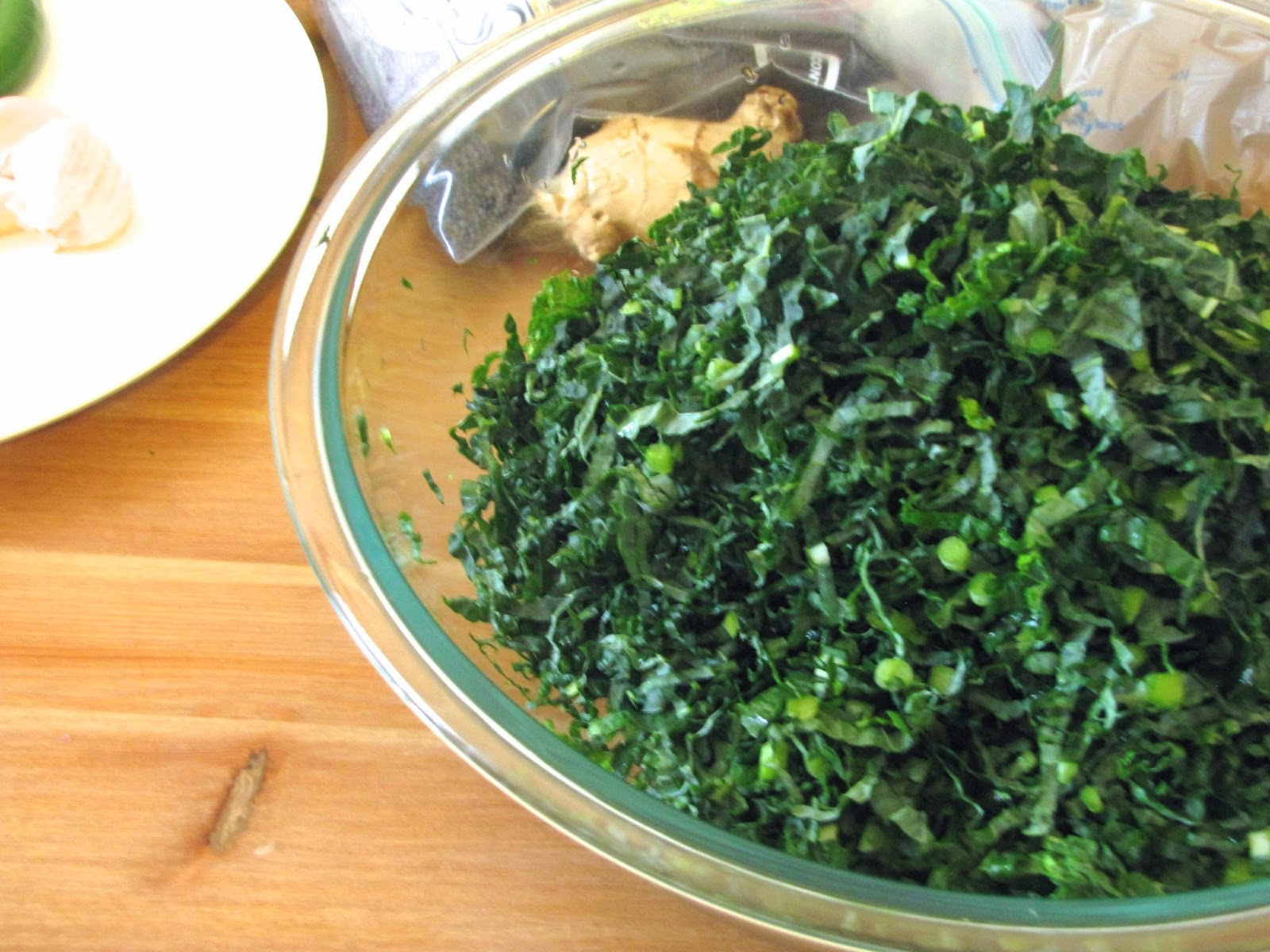 Finely shredded kale in a pyrex bowl.