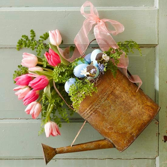 A vase with flowers and Easter eggs