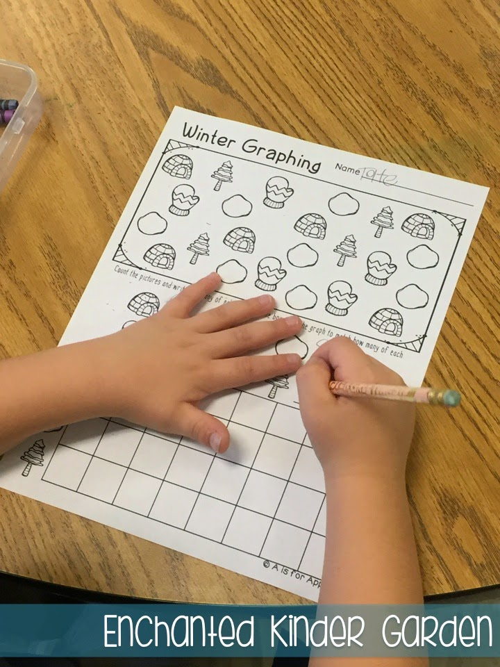 This is a photograph of a student completing a graphing activity for kindergarten.
