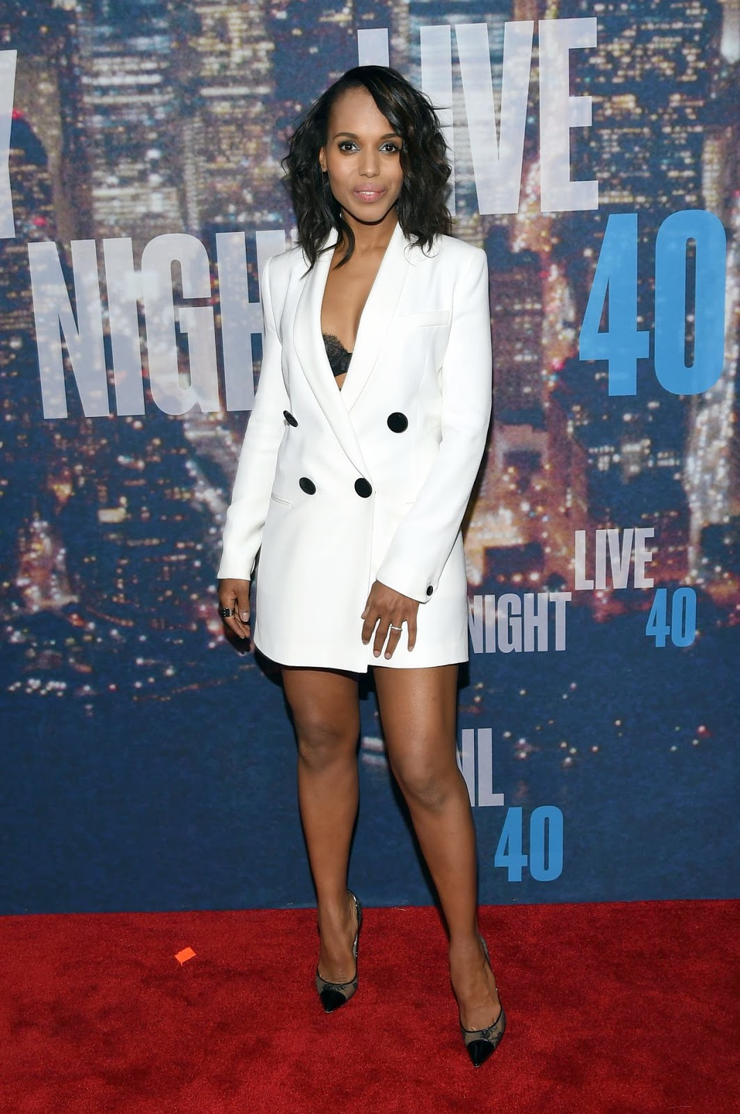 Kerry Washington shows lace bra in tuxedo inspired dress at the SNL 40th Anniversary Celebration in NY