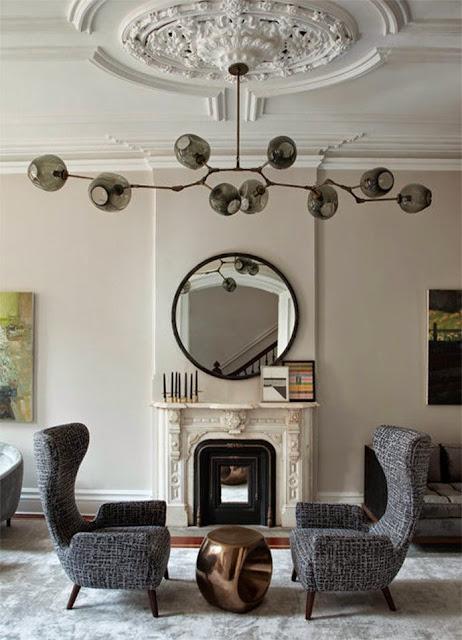 white living rom with bold modern lighting