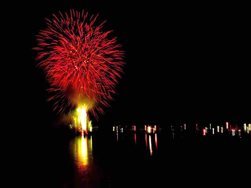 red,fireworks,reflection,ocean