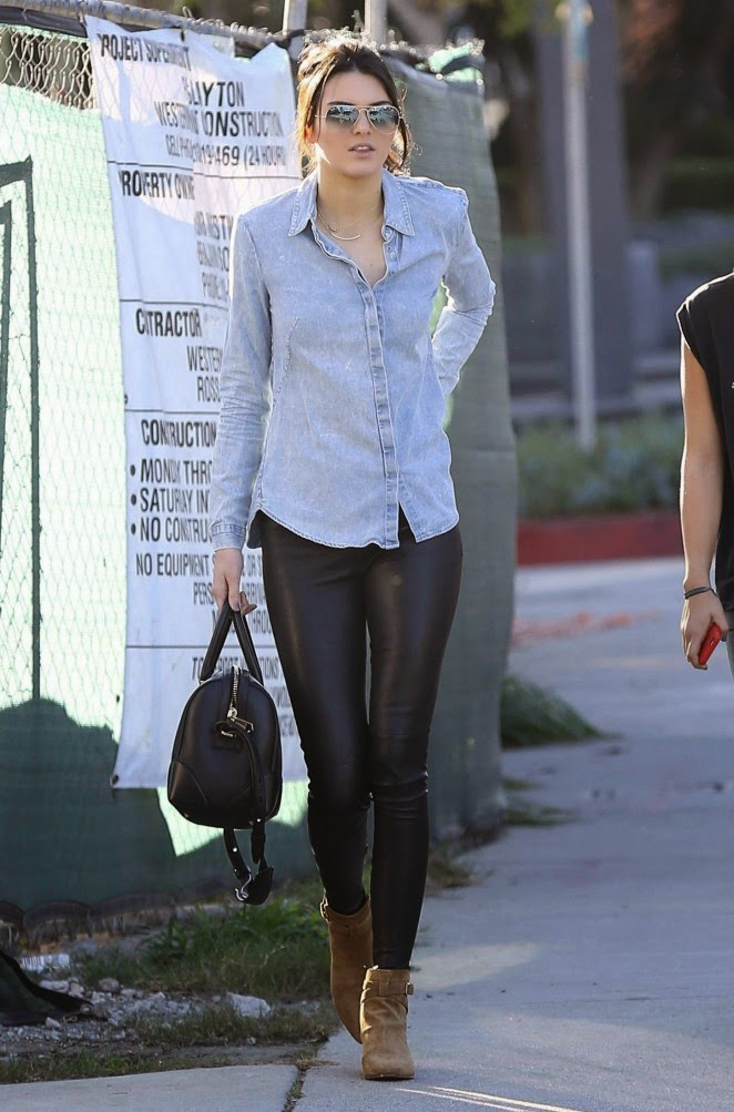 Kendall Jenner in a backless denim top and leather trousers in West Hollywood