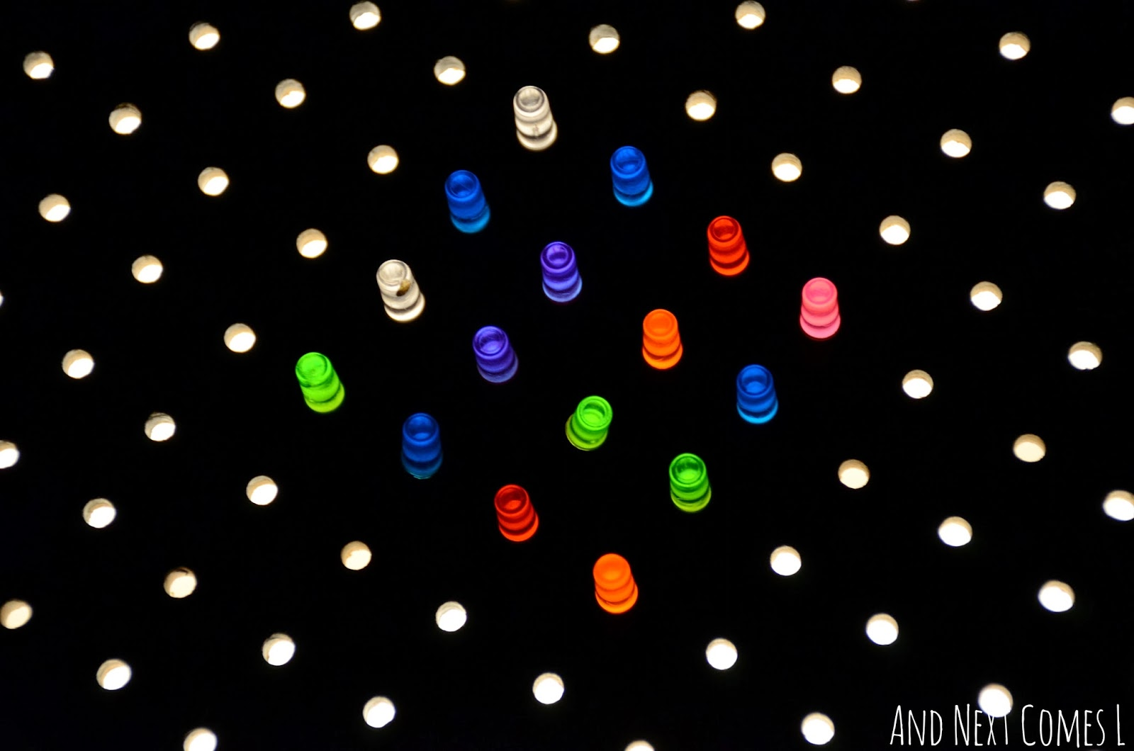 Close up of light bright pegs on a homemade light bright from And Next Comes L