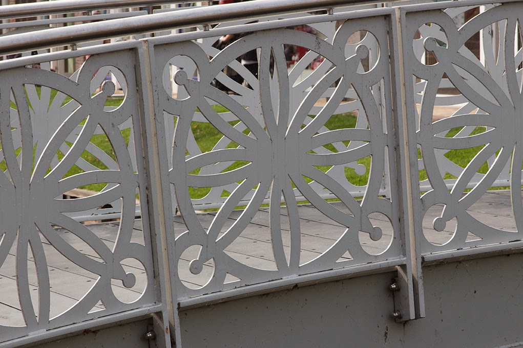 white patterned railing of bridge