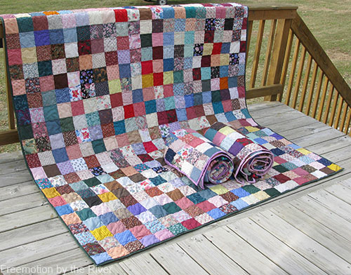 Full size scrappy quilt from 9 patch blocks at Freemotion by the River
