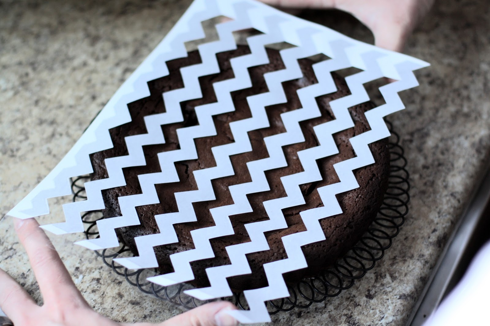 Chevron pattern on cake butter with a side of bread
