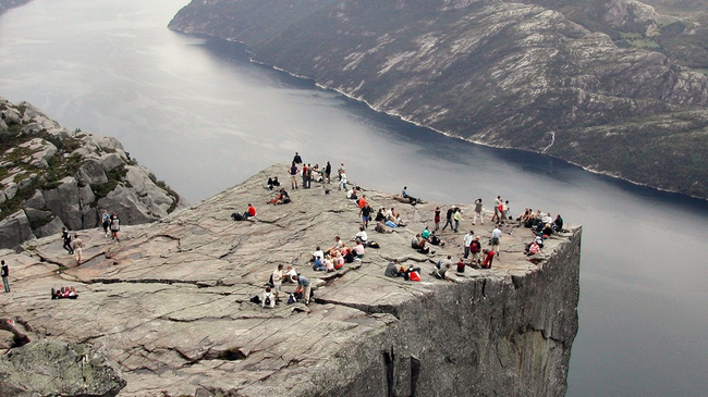 Preikestolen, or Pulpit Rock, is a popular tourist attraction in Norway. - What One Baby Was Found Doing In Norway Shocked People Everywhere.