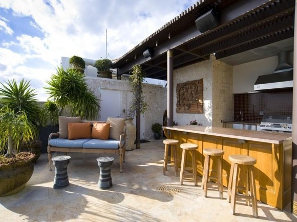 Photo of the private bar and bar chairs on the rooftop terrace
