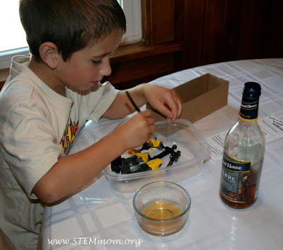 Boy pretending to wash his mummy in wine: STEMmom.org