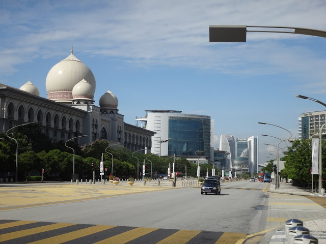 The main street with the famous landmarks of  Palace of Justice and the office building of Ministry of Natural Resources and Environment in Putrajaya, Malaysia