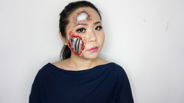 Robot SFX Makeup tutorial inspired by the terminator with things you find at home. In this tutorial, i will show you how to get the robotic metallic skin underneath your skin using face paint and a few house hold items.