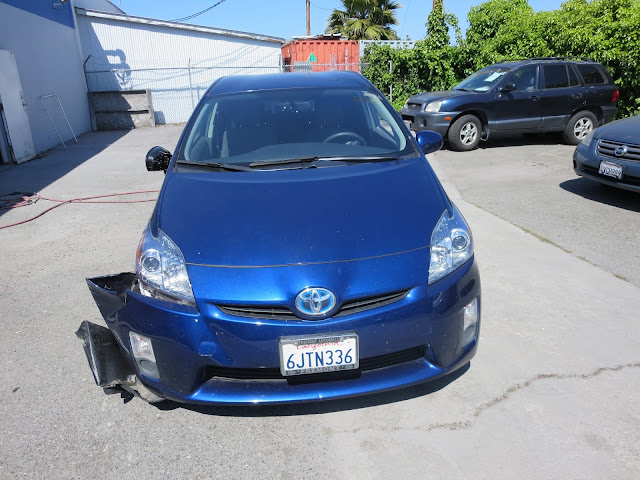 Prius with collision damage before repairs at Almost Everything Auto Body