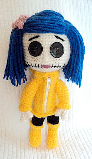 yellow crochet doll with blue hair button eyes