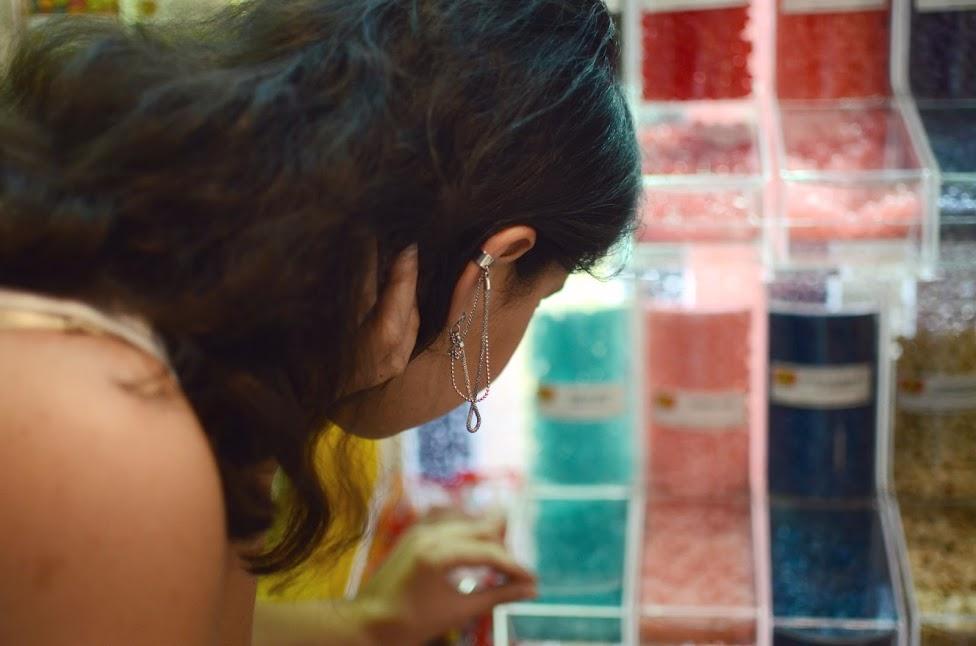 the serial shopper choosing candies